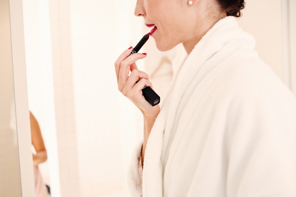 Bride applying lipstick - Picture by Kate Harrison Photography
