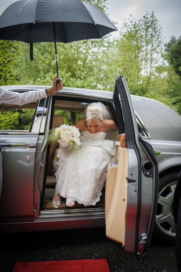 Bride getting out of Rolls Royce Phantom wedding car - Picture by Pixies in the Cellar