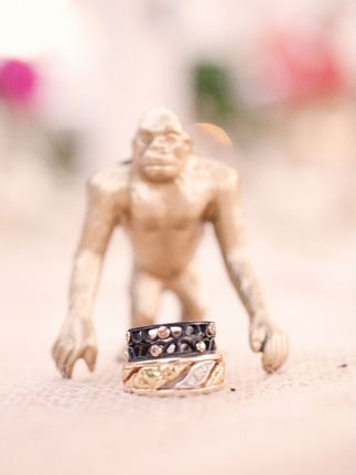 Small gold figure with wedding rings - Picture by Kate Harrison Photography