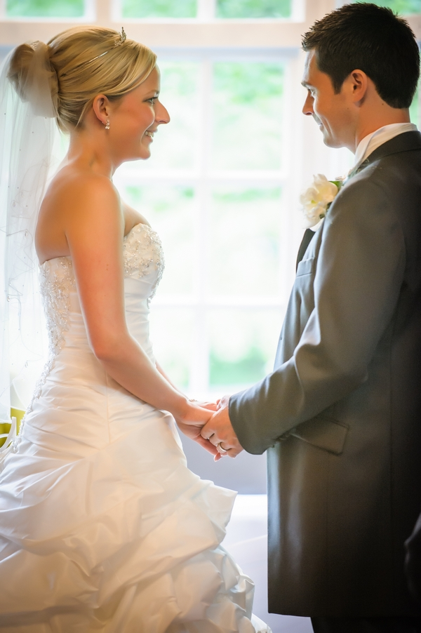 Bride and groom holding hands - Picture by Pixies in the Cellar