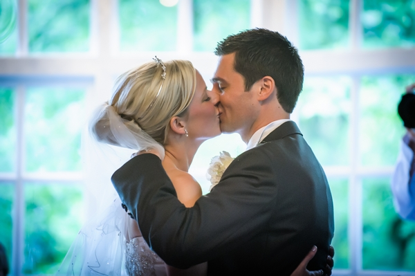 Bride and groom first kiss - Picture by Pixies in the Cellar