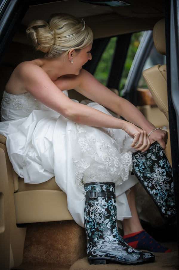 Bride putting on wellies - Picture by Pixies in the Cellar