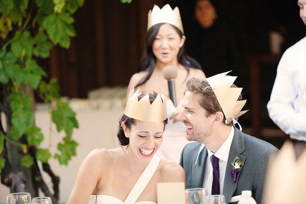 Bride and groom wearing paper crowns - Picture by Kate Harrison Photography
