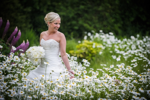 Bride walking through flowers - Picture by Pixies in the Cellar