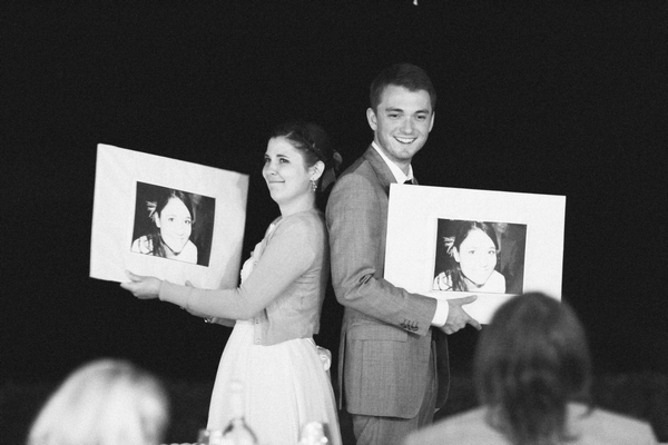 Bride and groom holding up pictures - Picture by DanielRM