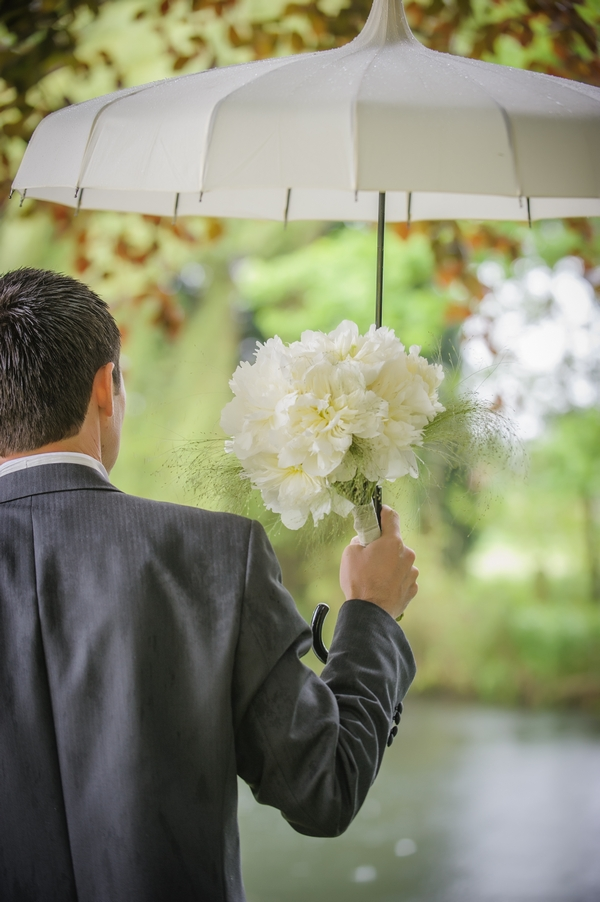 Groom holding umbrella - Picture by Pixies in the Cellar