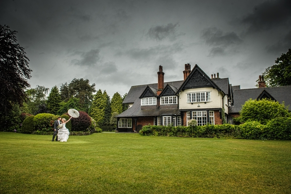 Bride and groom in grounds of Mere Court - Picture by Pixies in the Cellar