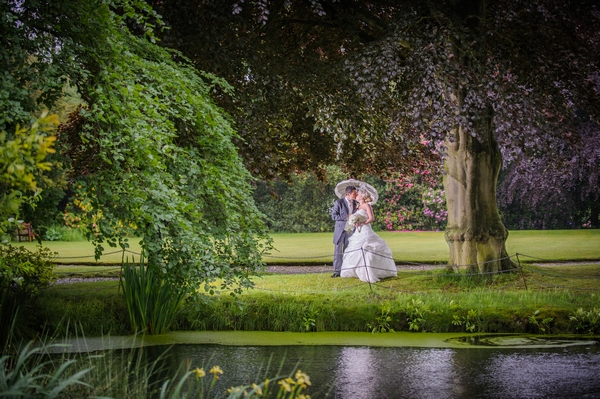 Bride and groom kissing under tree - Picture by Pixies in the Cellar
