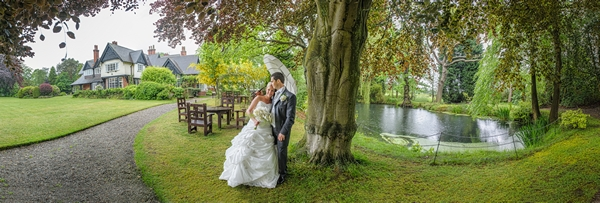 Bride resting her head on groom's shoulder under tree - Picture by Pixies in the Cellar
