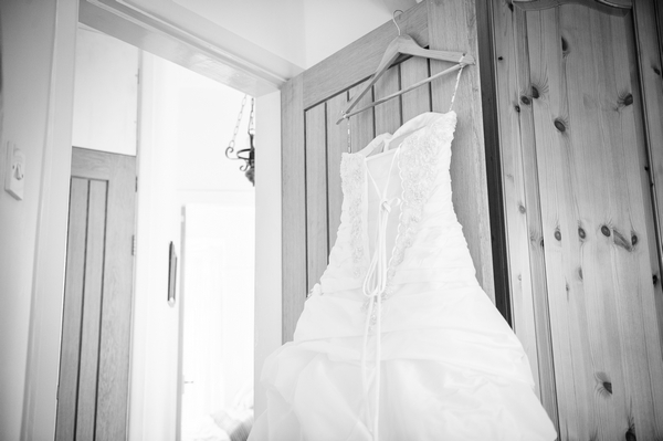 Wedding dress hanging on door - Picture by Pixies in the Cellar