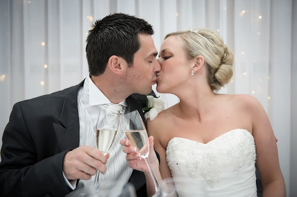 Bride and groom kissing - Picture by Pixies in the Cellar
