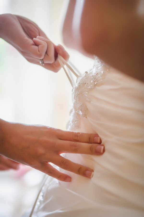 Hands tightening wedding dresss - Picture by Pixies in the Cellar