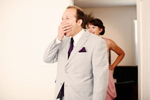 Man with hand over mouth after seeing bride - Picture by Kate Harrison Photography