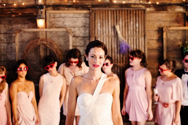 Bride and bridesmaids in barn - Picture by Kate Harrison Photography