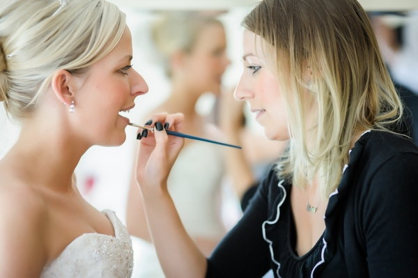 Bride having lipgloss applied - Picture by Pixies in the Cellar