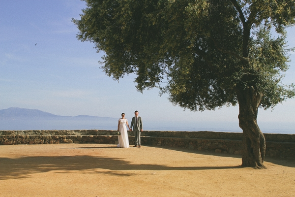 Bride and groom standing under a tree in Corsica - Picture by DanielRM