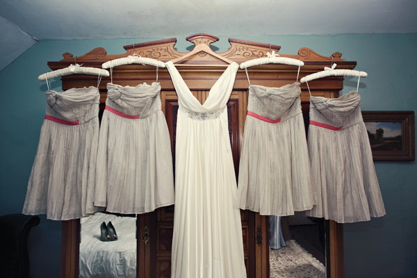 Wedding and bridesmaid dresses hanging on wardrobe - A Homemade Marquee Wedding