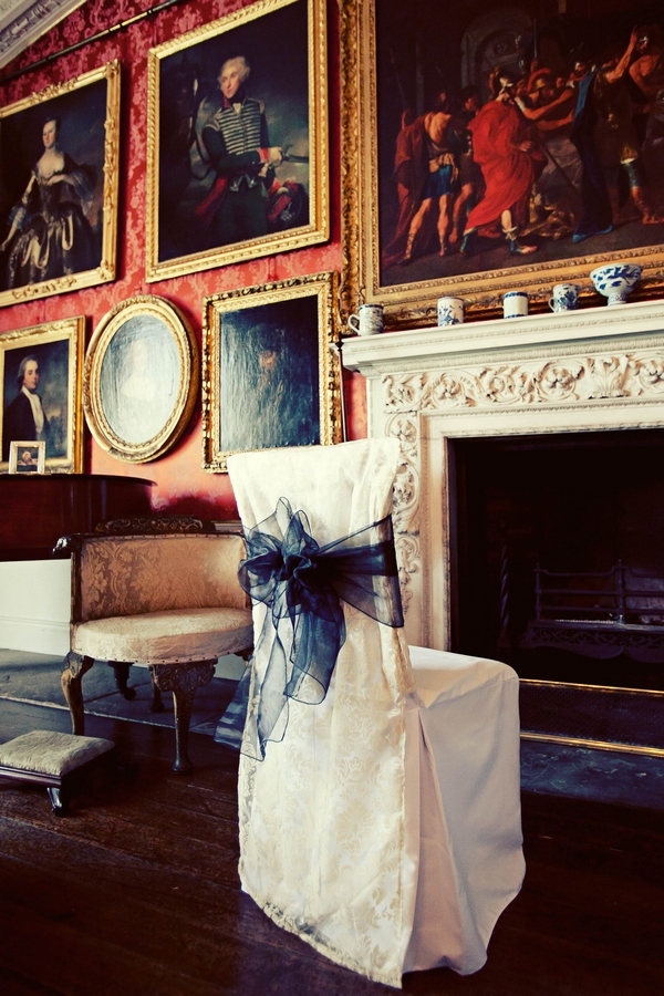 Chair with white chair cover and dark blue sash - Gothic Wedding Photo Shoot at Browsholme Hall