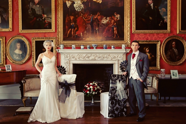 Bride and groom standing by fireplace - Gothic Wedding Photo Shoot at Browsholme Hall