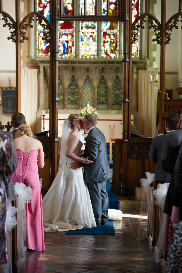 Bride and groom kiss at altar - Picture by Gareth Squance Photography
