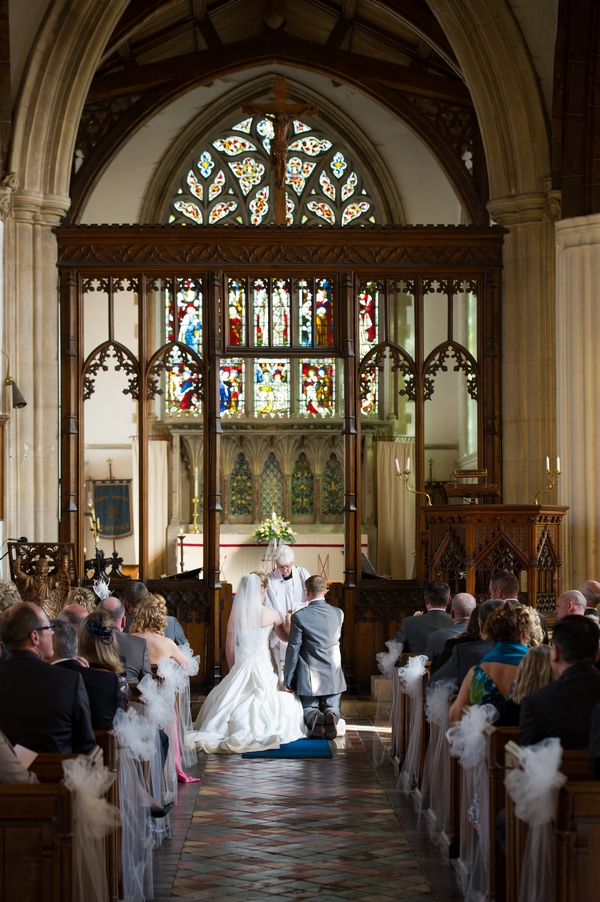 Bride and groom kneeling - Picture by Gareth Squance Photography