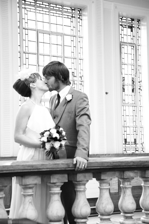 Bride and groom kiss on balcony - Picture by Rebecca Prigmore Photography