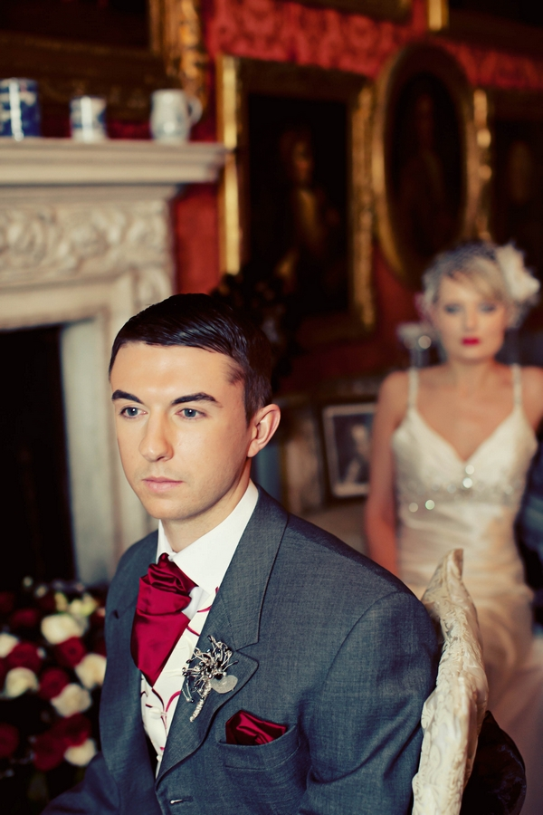 Groom with bride in background - Gothic Wedding Photo Shoot at Browsholme Hall