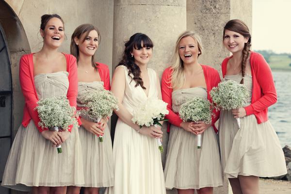 Bride posing with bridesmaids - A Homemade Marquee Wedding