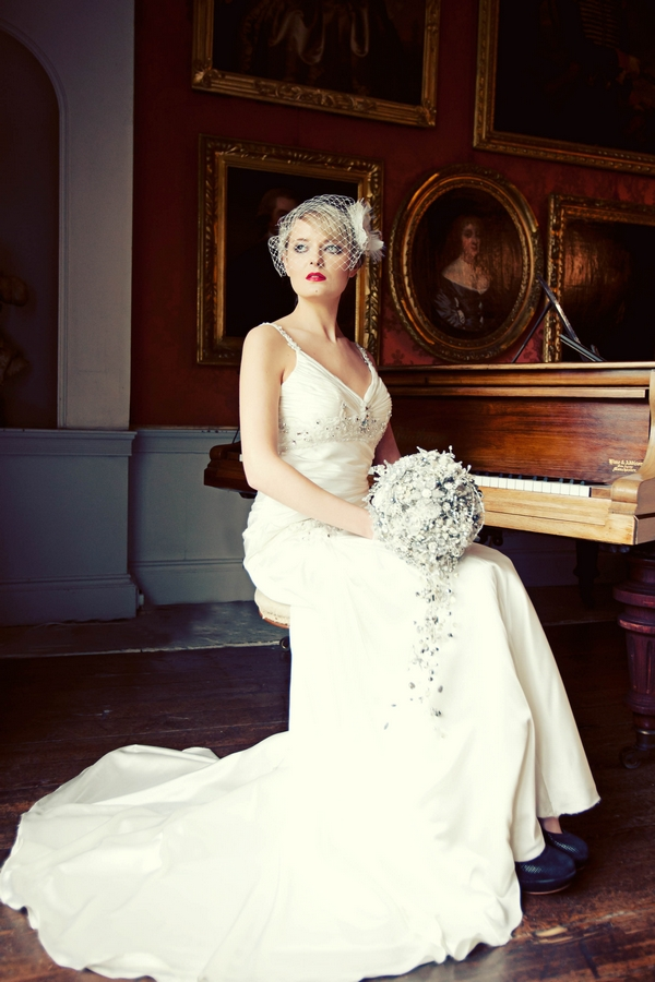 Bride sitting by piano - Gothic Wedding Photo Shoot at Browsholme Hall