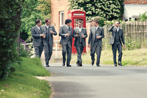 Groom and groomsmen walking to wedding - A Homemade Marquee Wedding