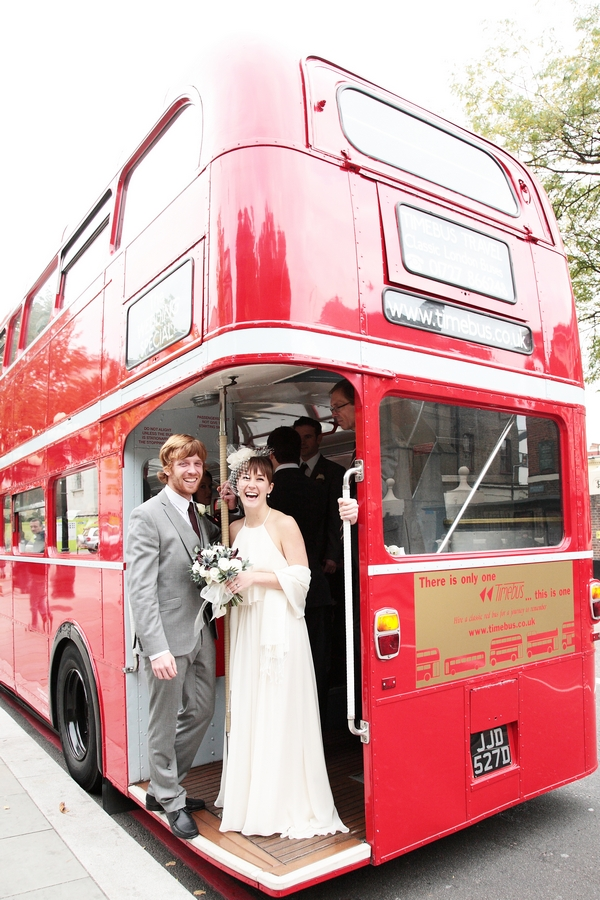 Bride and groom on back of red London bus - Picture by Rebecca Prigmore Photography