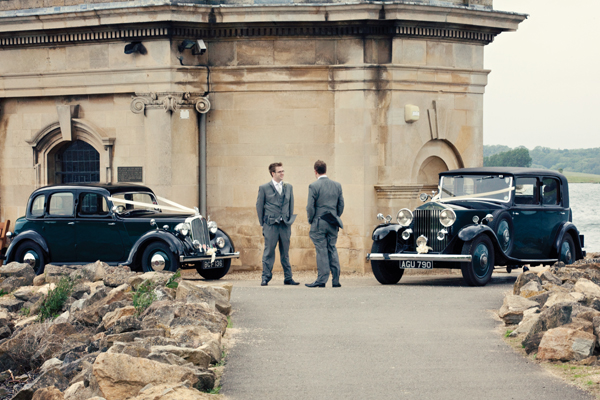 Groom and best man standing by vintage wedding cars - A Homemade Marquee Wedding