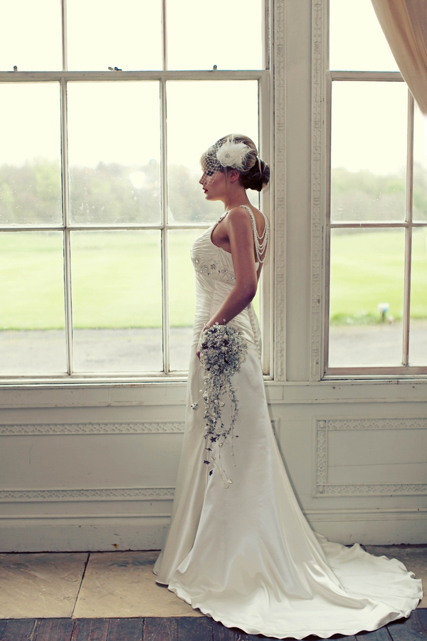 Bride looking out of window - Gothic Wedding Photo Shoot at Browsholme Hall