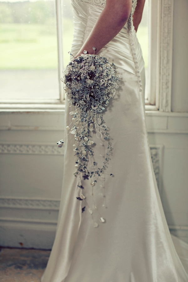 Bride holding crystal brooch bridal bouquet - Gothic Wedding Photo Shoot at Browsholme Hall