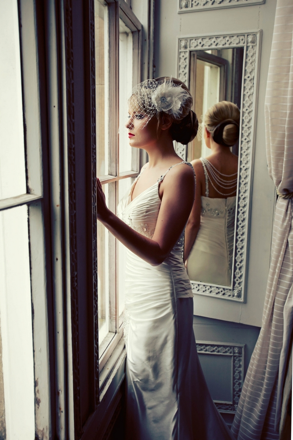 Bride gazing out of window - Gothic Wedding Photo Shoot at Browsholme Hall