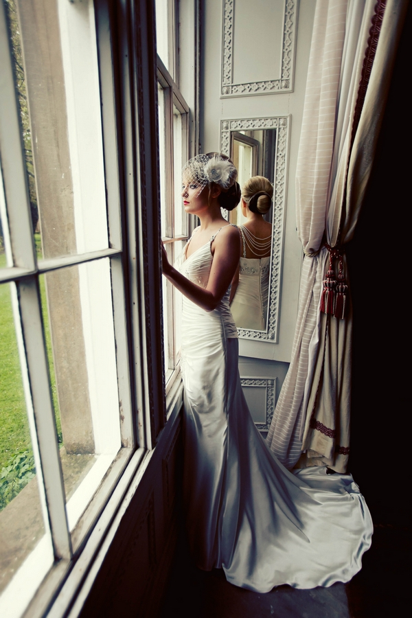 Bride in long wedding dress looking out of window - Gothic Wedding Photo Shoot at Browsholme Hall