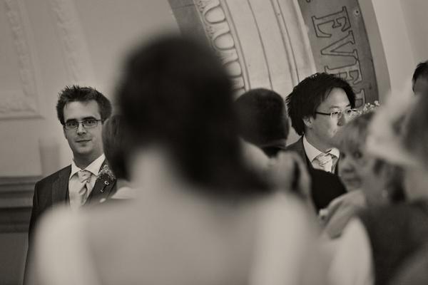 Groom watching bride walk down aisle - A Homemade Marquee Wedding