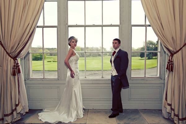 Bride and groom standing by window - Gothic Wedding Photo Shoot at Browsholme Hall
