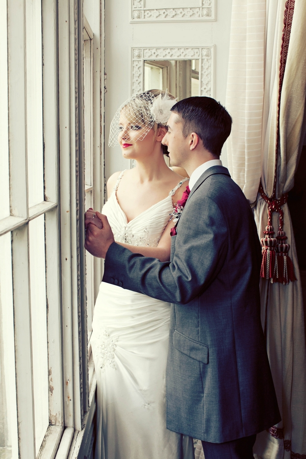 Bride and groom holding hands by window - Gothic Wedding Photo Shoot at Browsholme Hall