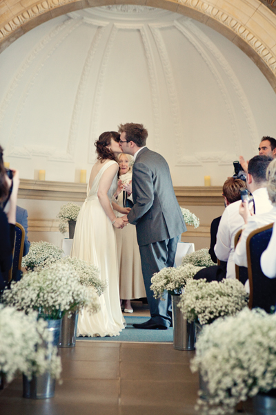 Bride and groom kiss in wedding ceremony - A Homemade Marquee Wedding
