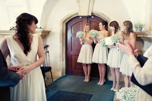 Bride turning to look at bridesmaids - A Homemade Marquee Wedding