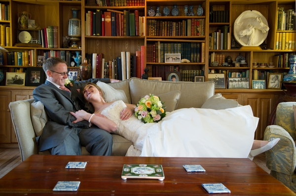Bride and groom on sofa - Picture by Gareth Squance Photography