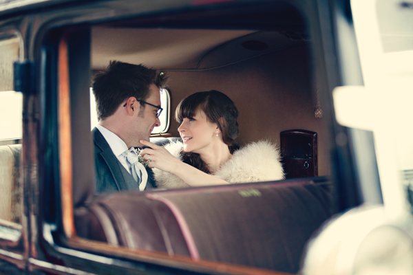 Bride and groom in back of wedding car - A Homemade Marquee Wedding