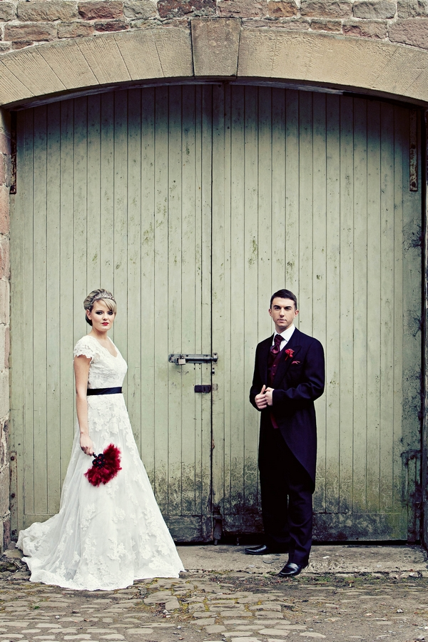 Bride and groom in front of barn door - Gothic Wedding Photo Shoot at Browsholme Hall