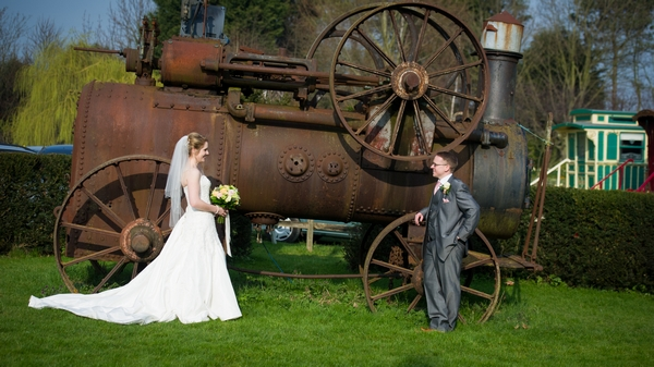 Bride and groom by old farm machinery - Picture by Gareth Squance Photography