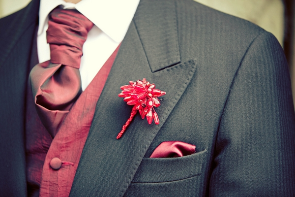 Red crystal buttonhole on groom's suit - Gothic Wedding Photo Shoot at Browsholme Hall