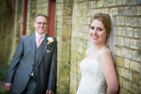 Bride and groom leaning against wall - Picture by Gareth Squance Photography