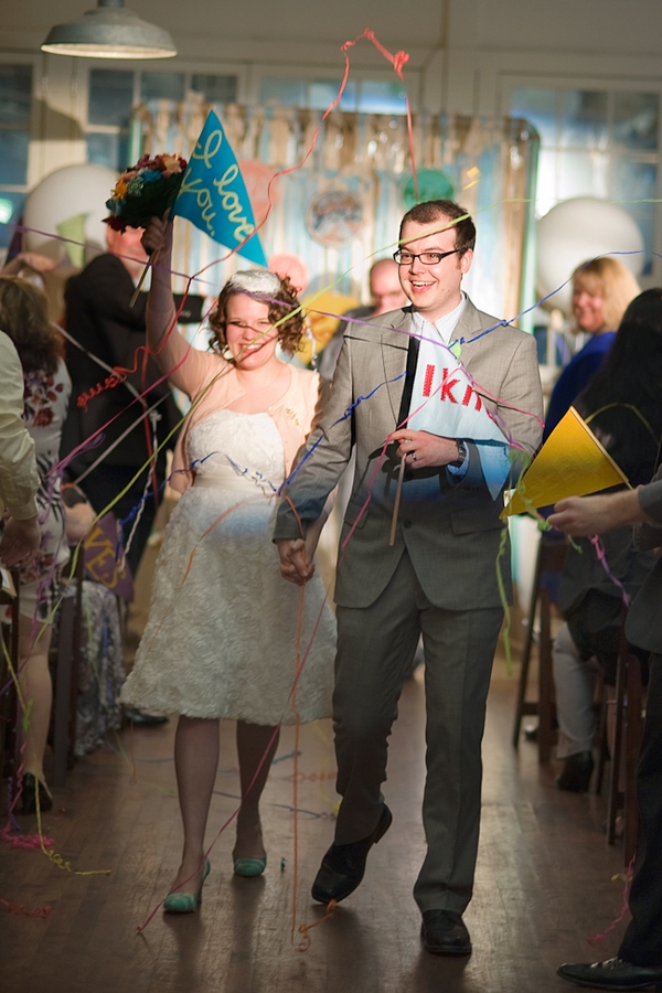 Bride and groom leaving wedding ceremony hand in hand - A Fun, Fun, Fun Wedding