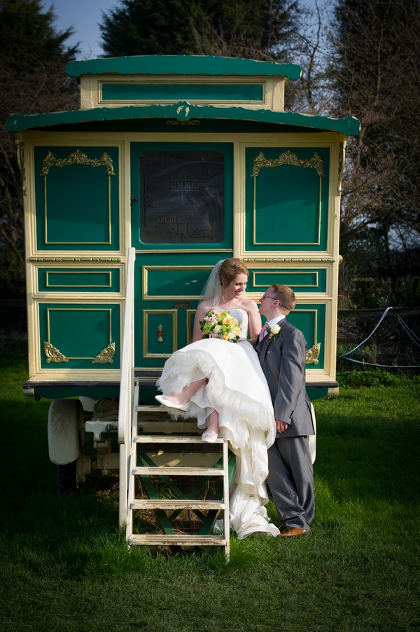 Bride and groom by small green caravan - Picture by Gareth Squance Photography