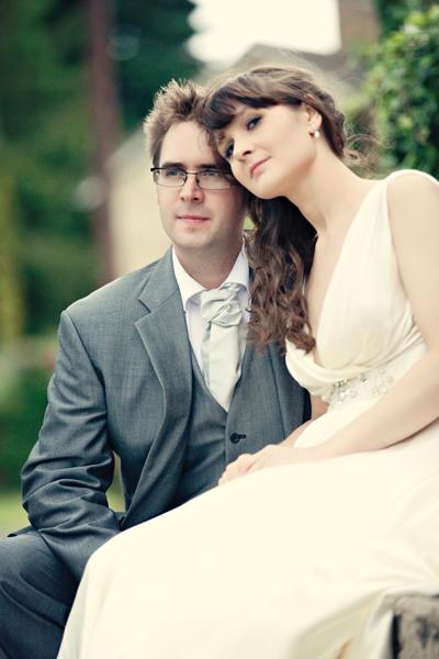 Bride sitting resting head on groom - A Homemade Marquee Wedding